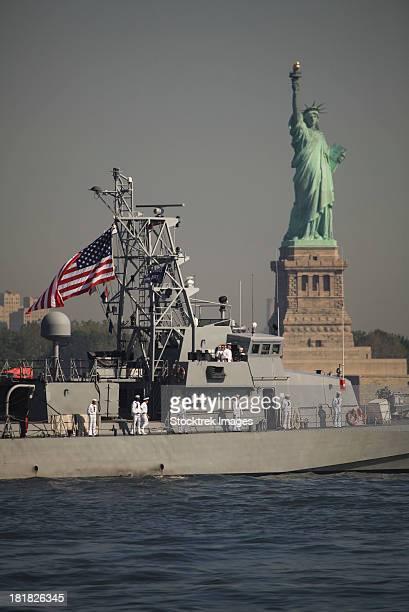 May 26, 2010 - Fleet week vessels pass by the Statue of Liberty, marking the beginning of Fleet Week 2010 in New York.