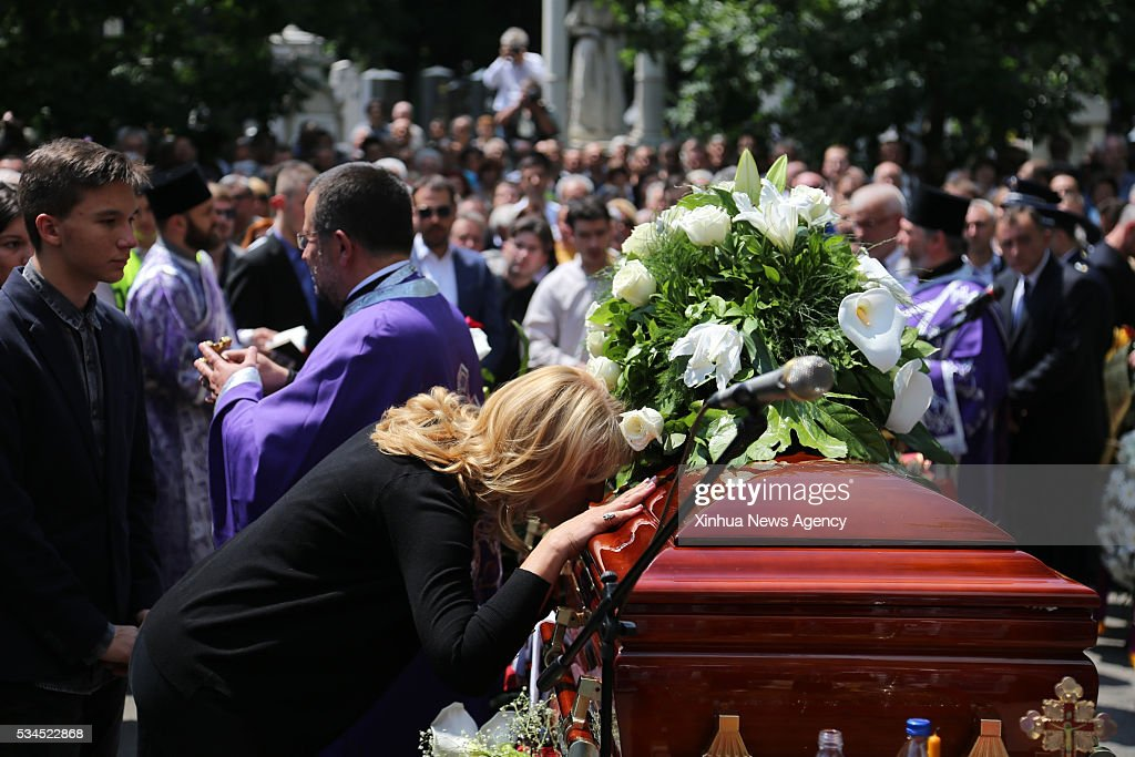 Daughter of Velimir Bata Zivojinovic, one of the big stars of the Yugoslavian films, who died on May 22 at the age of 83, kisses his coffin on his funeral held at the New Cemetery in Belgrade, capital of Serbia, May 26, 2016.