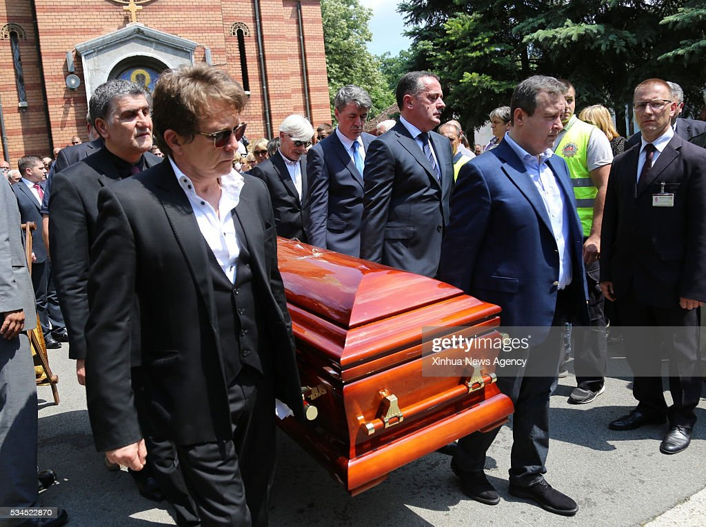 Minister of Foreign Affairs of Serbia Ivica Dacic, second right front, carries the coffin of Velimir Bata Zivojinovic, one of the big stars of the Yugoslavian films, who died on May 22 at the age of 83, on his funeral held at the New Cemetery in Belgrade, capital of Serbia, May 26, 2016.