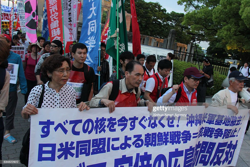 People take part in a protest against the visit by U.S. President Barack Obama, near the Hiroshima Peace Memorial Park in Hiroshima, Japan, May 26, 2016. Leaders of the Group of Seven kicked off a summit in Japan on Thursday, but economic policy divergence among the members and protests in Okinawa against U.S. military are expected to shroud the gathering. Obama is also planned to visit Hiroshima on Friday accompanied by Japanese Prime Minister Shinzo Abe, marking the first sitting U.S. president to visit the city that was obliterated by U.S. atomic bombing at the end of World War II.