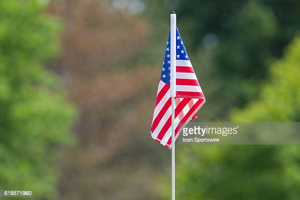 The America Flag marks the hole on the No 9 green during the first round of the inaugural LPGA Volvik Championship at Travis Pointe Country Club in...