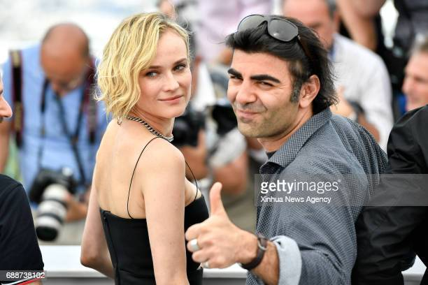 CANNES May 26 2017 Director Fatih Akin and actress Diane Kruger of the film 'In the Fade' pose for a photocall in Cannes France on May 26 2017 The...
