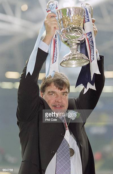 Bolton Wanderers Manager Sam Allardyce holds the trophy aloft after the Nationwide Division One Playoff Final win against Preston North End at the...