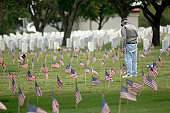 May 28, 2006 - A family member pays his respects at a grave site at Fort Sam Houston National Cemetery in San Antonio.