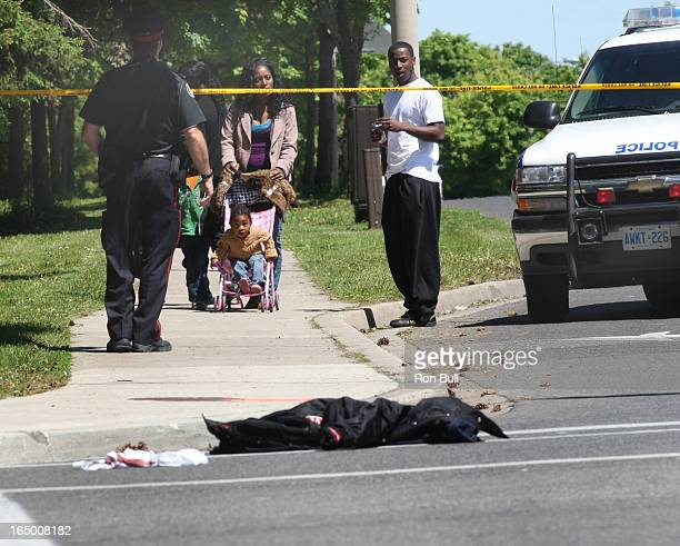 May 28 2008 Shooting RB08 Shooting scene on Sewells Rd and McLevin Ave with clothing shoes jacket pants cap and blood stained white material possibly...