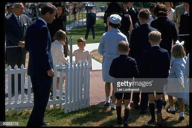 Grave site of slain President Kennedy on first birthday after assassination Robert F Kennedy Jacqueline Kennedy Caroline John Jr Ethel Kennedy w her...