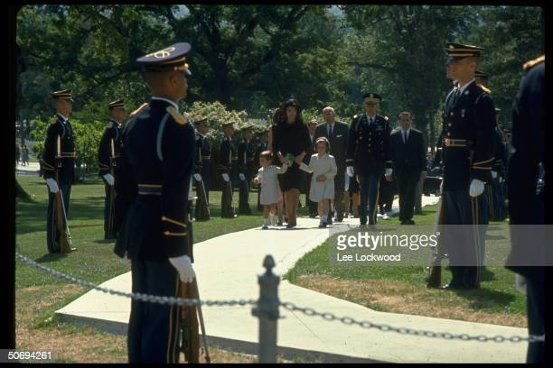 Jacqueline Kennedy w children John Jr and Caroline seen at middistance followed by Robert F Kennedy brother of slain President arriving at the grave...