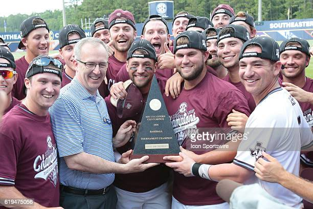 Texas AM players accept the tournament champion trophy from SEC Commissioner Greg Sankey during the Texas AM versus Florida Final Round game of the...