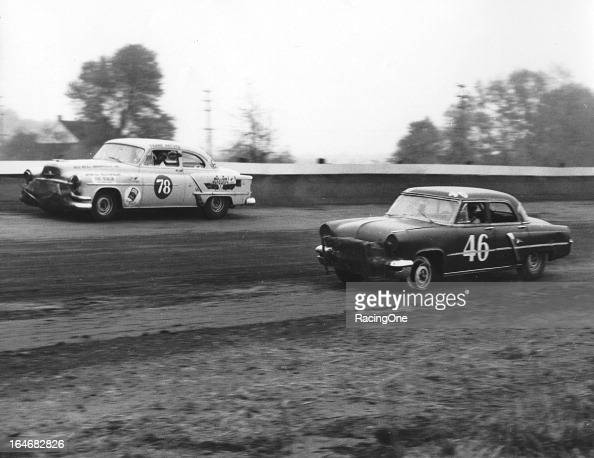 Dick Passwater in a 1953 Oldsmobile passes Ralph Ligouri who is having a tire issue with his 1953 Lincoln during a NASCAR Cup race at Langhorne...