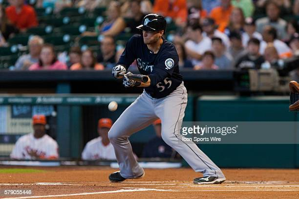 Seattle Mariners right fielder Michael Saunders bunting the ball during the game against the Houston Astros at Minute Maid Park in Houston