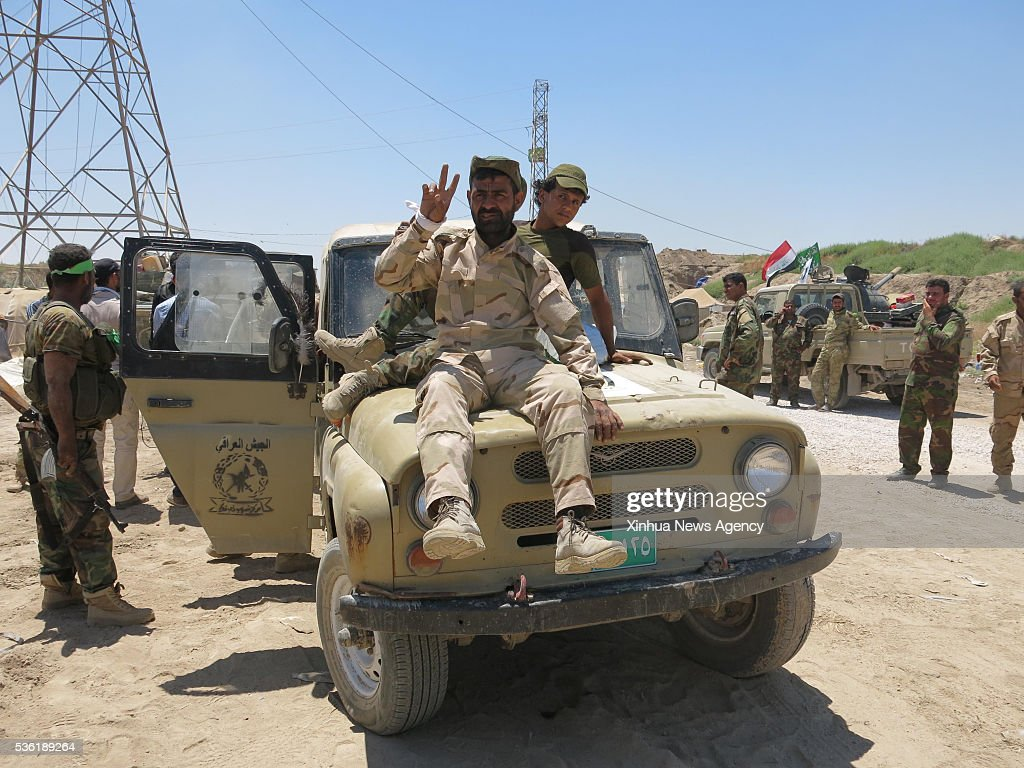 FALLUJAH, May 30, 2016 -- A fighter from a Shiite paramilitary group, known as Hashd Shaabi, sits on a military vehicle on the way to the frontline to fight against Islamic State in Saqlawiyah, in northwest of Fallujah city, Iraq, on May 30, 2016. Iraqi security forces on Monday launched the final stage of an offensive aimed at freeing the city of Fallujah and nearby areas from Islamic State militants, security sources said.