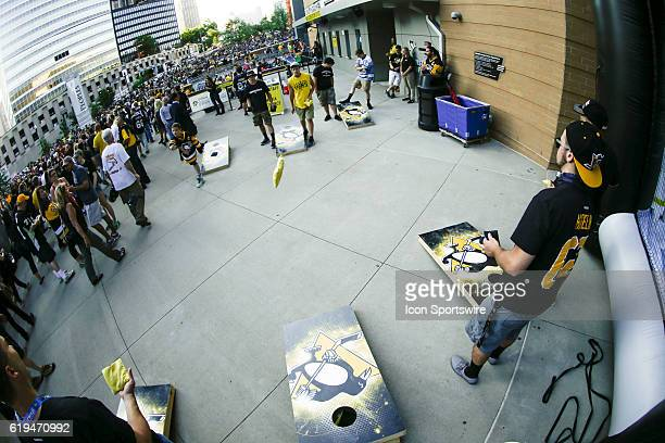 Penguins fans enjoy bean bag toss prior to the San Jose Sharks and Pittsburgh Penguins NHL Stanley Cup playoff game at Consol Energy Center in...