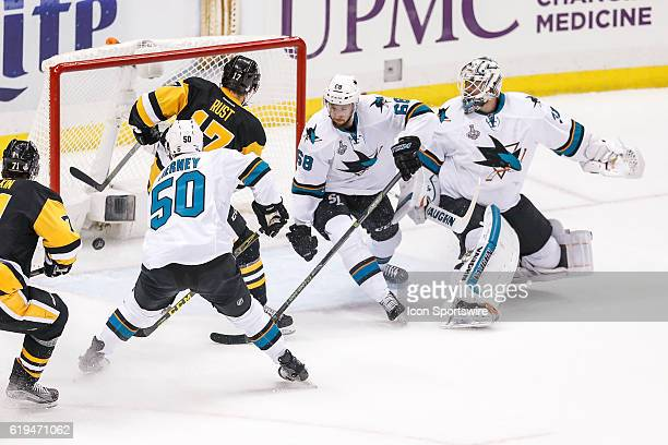 Pittsburgh Penguins right wing Bryan Rust scores first goal of the game as San Jose Sharks center Chris Tierney San Jose Sharks right wing Melker...