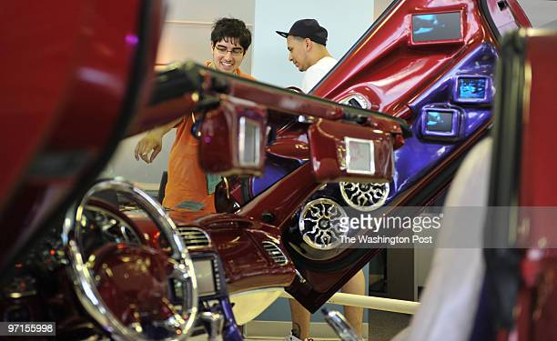 May 31 2009 PLACE Silver Spring MD PHOTOGRAPHER jahi chikwendiu/twp Mike Yoler left and Javier Canales both of Silver Spring MD check out cars at a...