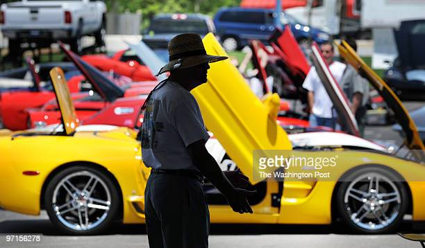 May 31 2009 PLACE Silver Spring MD PHOTOGRAPHER jahi chikwendiu/twp Jim Byrd of Ellicott City MD checks out cars at a Corvette car show in Silver...