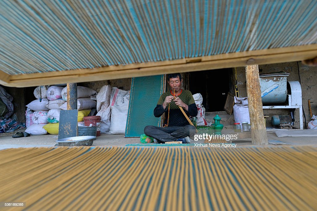 LHASA, May 31, 2016 -- Gyalpo makes traditional Tibetan incense in Toinba Town of Nyemo County, southwest China's Tibet Autonomous Region, May 26, 2016. Nyemo County is renowned for Tibetan incense by making use of local natural resources, like adequate water supply, favorable climate and various plants. Villagers there have been specializing in incense production with a history of more than 1,000 years. This fragrant incense often serves sacrificial ceremonies, and it also can be used to prevent infectious diseases.