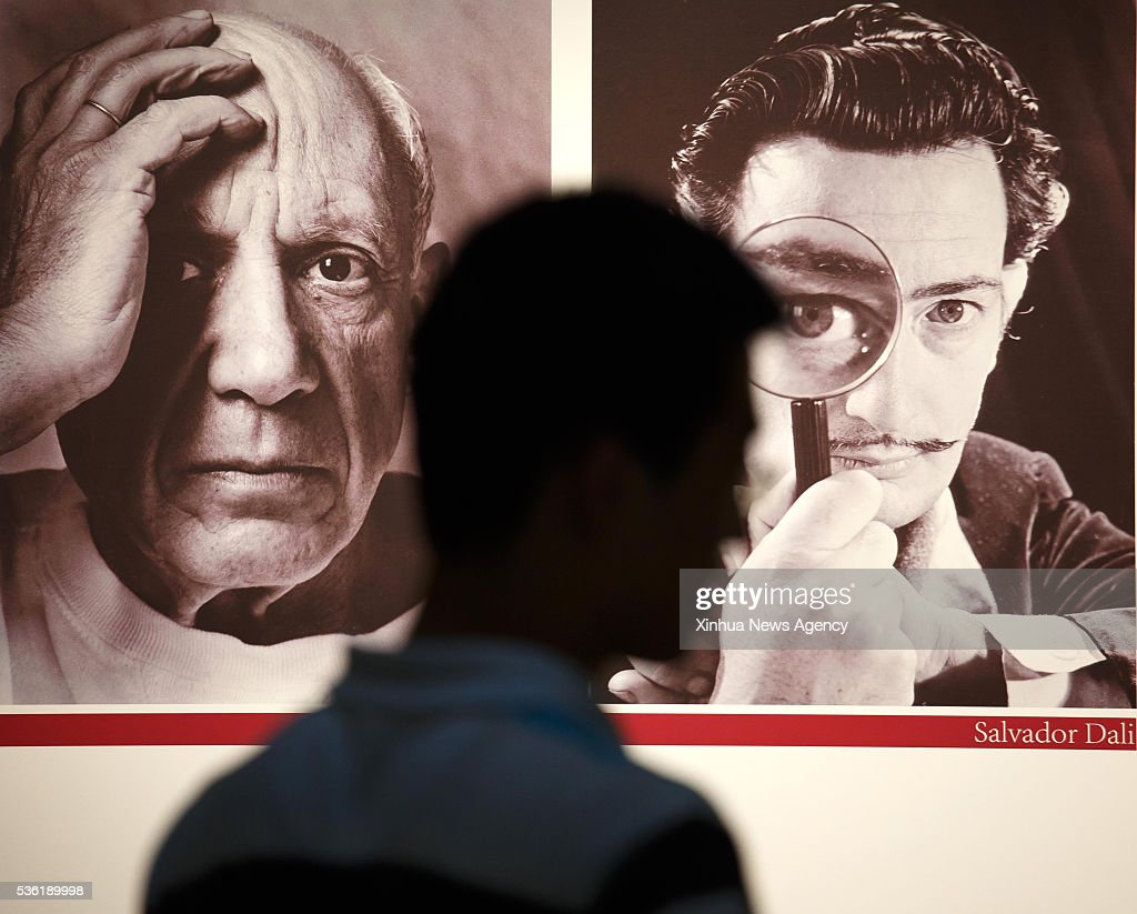NANTONG, May 31, 2016 -- People walk past a poster at the entrance of an exhibition of Spanish artist Pablo Picasso and Salvador Dali in Nantong, east China's Jiangsu Province, May 31, 2016. A total of 86 paintings, prints, sculptures and porcelain works of Pablo Picasso and Salvador Dali were displayed at the two-month exhibition that kicked off here on Tuesday.