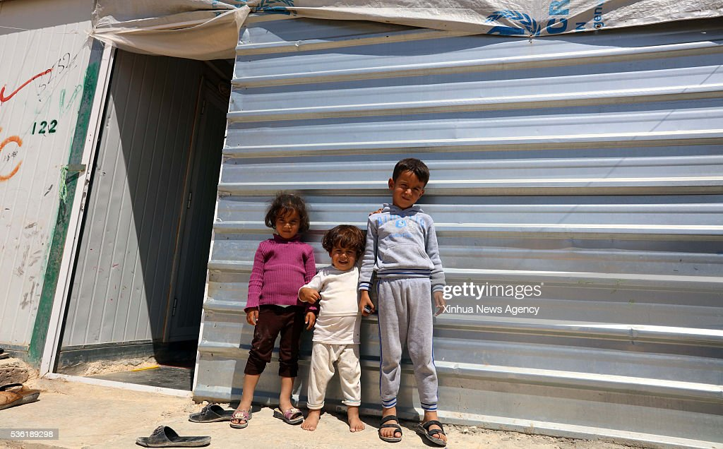 MAFRQ, May 31, 2016 (Xinhua) -- Syrian refugee children are seen in front of their tent at the Zattari Syrian refugee camp near the city of Mafraq, Jordan, May 30, 2016.