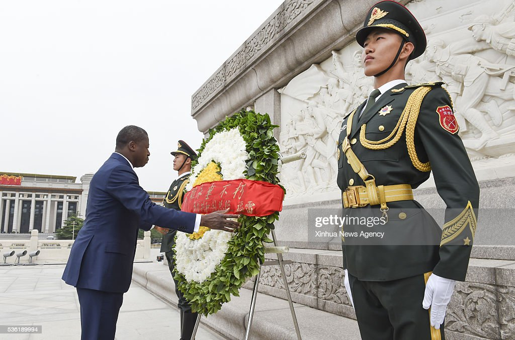 BEIJING, May 31, 2016-- Togolese President Faure Gnassingbe lays a wreath to the Monument to the People's Heroes at the Tian'anmen Square in Beijing, capital of China, May 31, 2016.