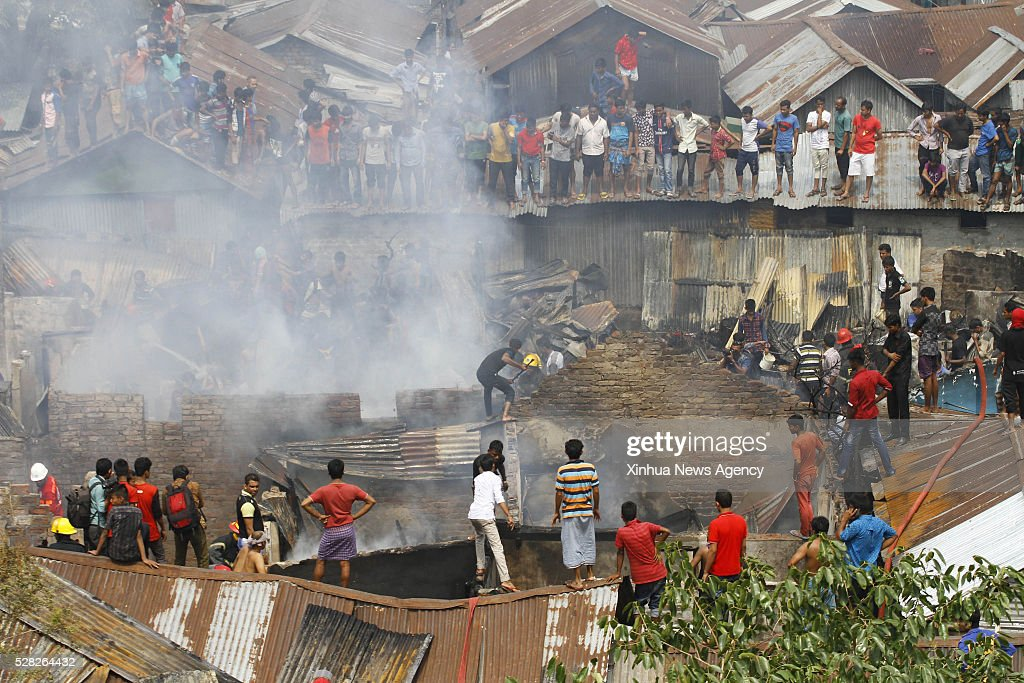 DHAKA, May 4, 2016-- Bangladeshi slum dwellers and firefighters try to extinguish fire at Farmgate in Dhaka, Bangladesh, May 4, 2016. A devastating fire raged through the slum area in Bangladeshi capital, destroying scores of homes Wednesday morning.