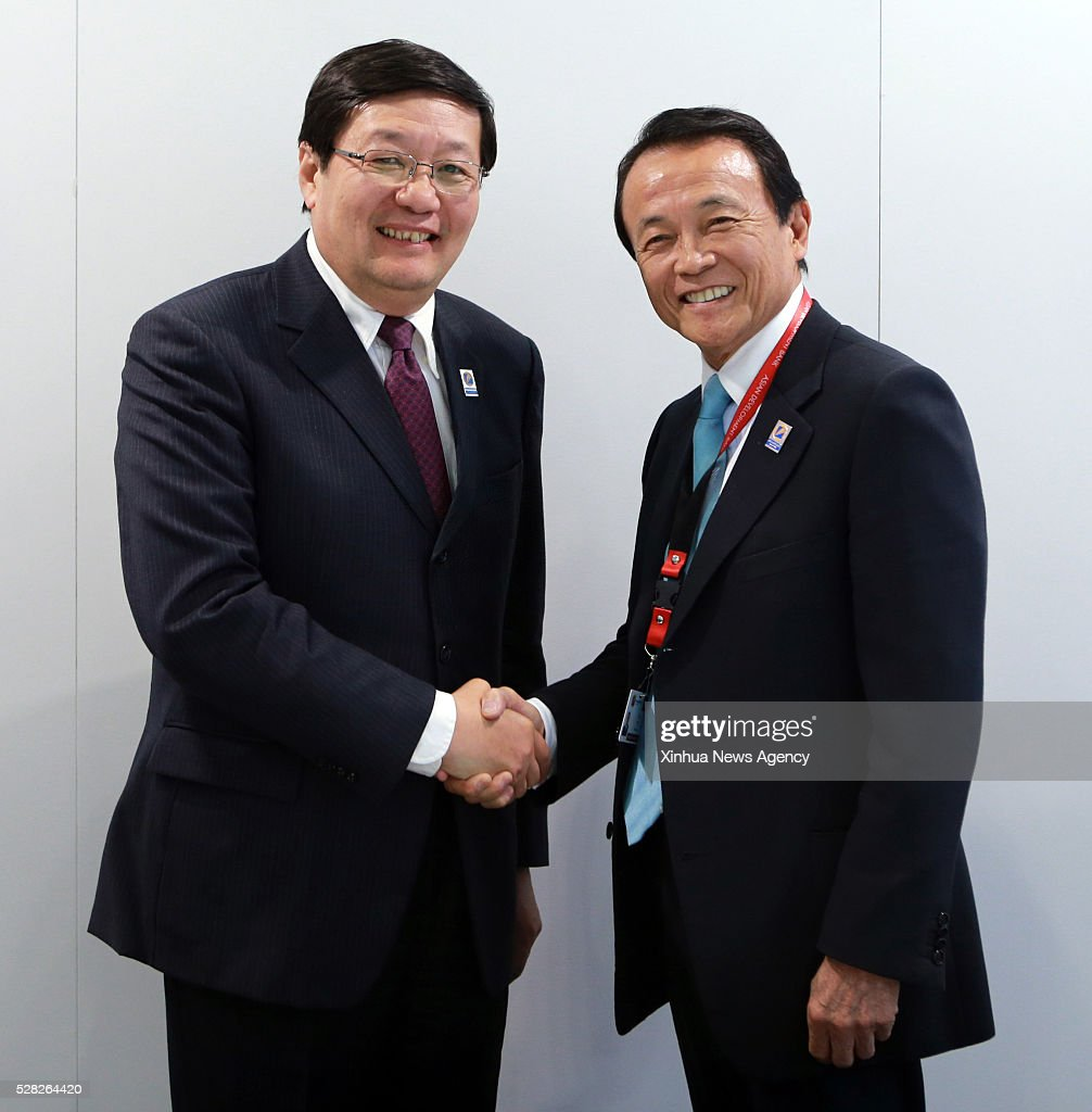 FRANKFURT, May 4, 2016-- Chinese Finance Minister Lou Jiwei, left, meets with Japanese Finance Minister Taro Aso at the 49th Annual Meeting of the Board of Governors of the Asia Development Bank in Frankfurt, Germany, on May 4, 2016.