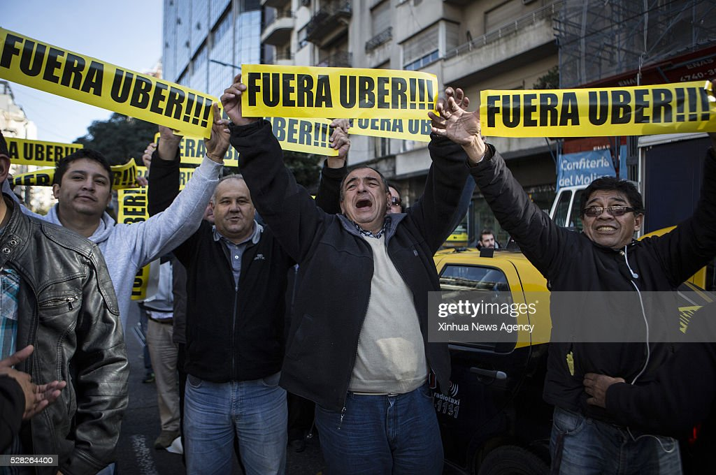 AIRES, May 4, 2016 -- Taxi drivers take part in a protest against Uber in Buenos Aires, Argentina, on May 4, 2016. Taxi drivers and owners blocked 10 traffic spots in the city with their cars to protest against the operation of Uber, according to local press.