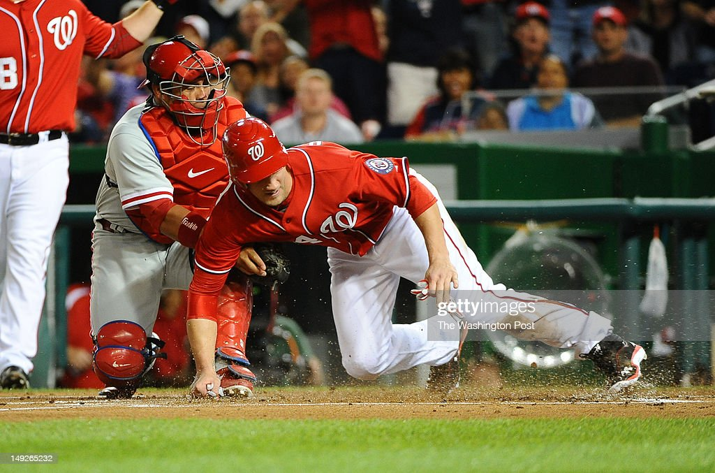 WASHINGTON, DC May 6, 2012 Washington Nationals left fielder Bryce Harper (34) is safe stealing home after avoiding the tag by Philadelphia Phillies catcher Carlos Ruiz (51) during 1st inning action on May 6, 2012 in Washington, DC