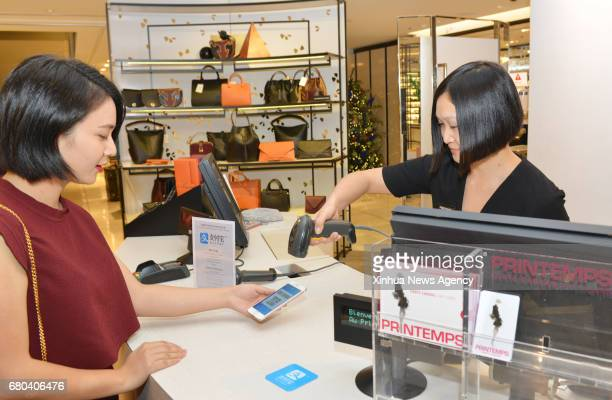 BEIJING May 8 2017 A cashier collects payment with Alipay at Printemps in Paris France Nov 3 2016 It is a common thing in China to take no cash and...