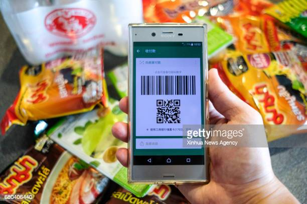 BEIJING May 8 2017 A Chinese customer prepares to pay with Wechat in Bangkok Thailand May 5 2017 It is a common thing in China to take no cash and...