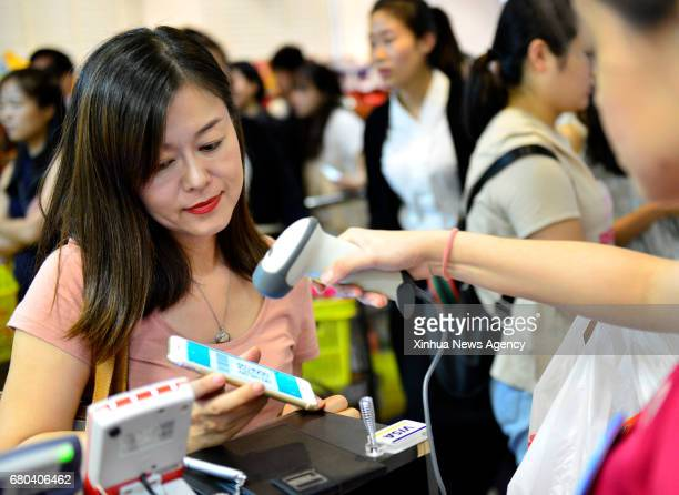 BEIJING May 8 2017 A customer pays with Alipay at a department store in Singapore Dec 11 2016 It is a common thing in China to take no cash and pay...