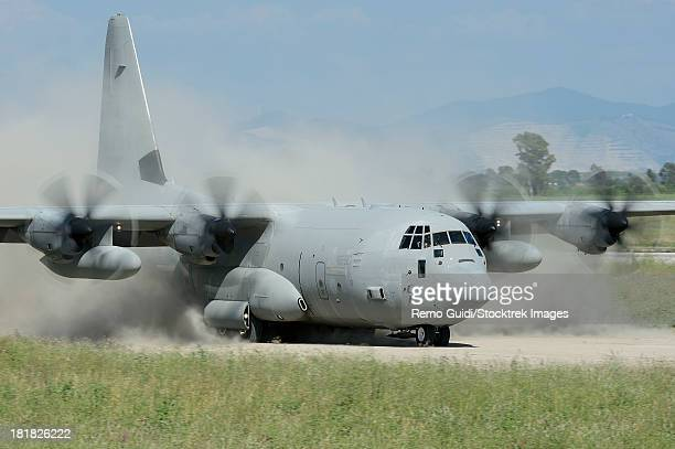 May 9, 2013 - A C-130 Hercules of the Italian Air Force landing on an unpaved landing strip, Grazzanise, Italy.