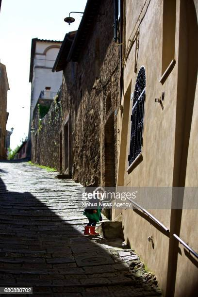 MONTALCINO May 9 2017 A girl plays in Montalcino Italy on May 6 2017 Montalcino is a medieval hill town in Tuscany of Italy It is famous for the...
