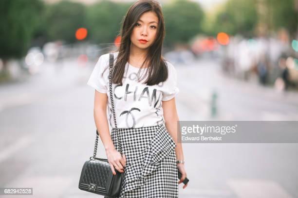 May Berthelot fashion blogger and Head of Legal at Videdressingcom wears a New Look black and white skirt a Chanel graffiti christmas 2008 limited...