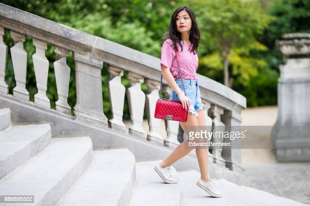 May Berthelot fashion blogger and Head of Legal at Videdressingcom wears a New Look Vichy red top a New Look ripped Mom blue denim short Converse...