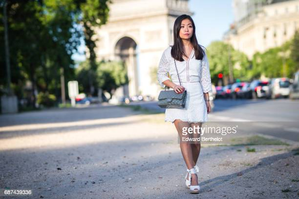 May Berthelot fashion blogger and Head of Legal at Videdressingcom wears a Lovie and Co lace white playsuit HM espadrille shoes and a Chanel Timeless...