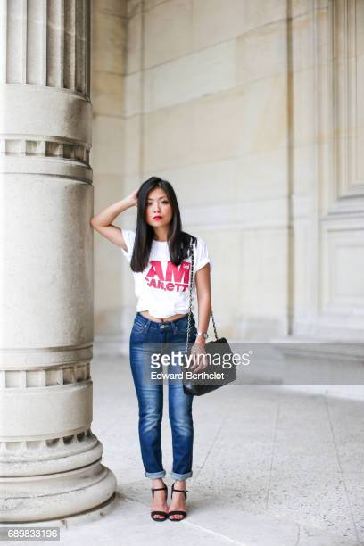 May Berthelot fashion blogger and Head of Legal at Videdressingcom wears a Lee white tshirt with the printed sentence in red 'I am a Scarlett' New...