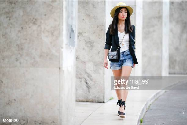 May Berthelot fashion blogger and Head of Legal at Videdressingcom wears a blazer jacket designed by herself a New Look white tshirt a The Kooples...