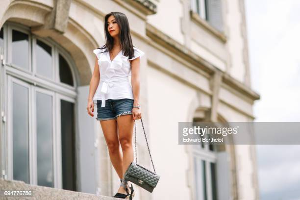 May Berthelot fashion blogger and Head of Legal at Videdressingcom wears an Asos white sleeveless top with ruffles a Levis blue denim short Christian...