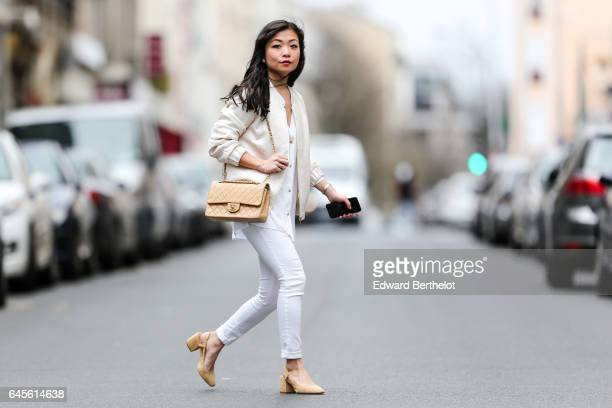 May Berthelot Head of Legal at Videdressingcom and fashion blogger wears a Lovie Co white jacket an Ivy Revel white shirt Topshop white denim jeans...