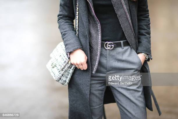 May Berthelot Head of Legal at Videdressingcom and fashion blogger wears a gray coat an Iro jacket an HM pull over a Gucci belt Zara gray pants New...