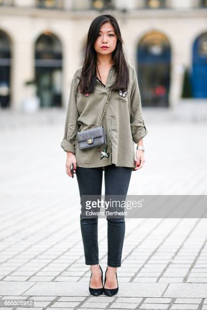 May Berthelot Head of Legal at Videdressingcom and fashion blogger wears a Lola Liza green khaki shirt with embroidered features Chanel denim jeans a...
