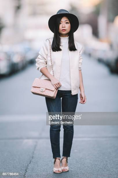 May Berthelot Head of Legal at Videdressingcom and fashion blogger wears a Maison Michel hat a Courreges top a Lovie and Co bomber jacket HM blue...