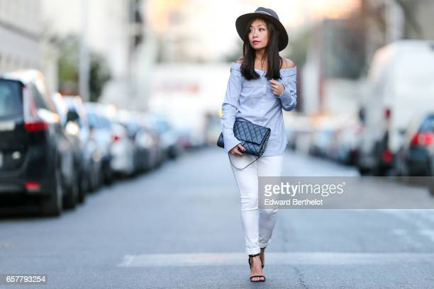 May Berthelot Head of Legal at Videdressingcom and fashion blogger wears a Maison Michel hat a New Look off shoulder striped top Topshop jeans Asos...