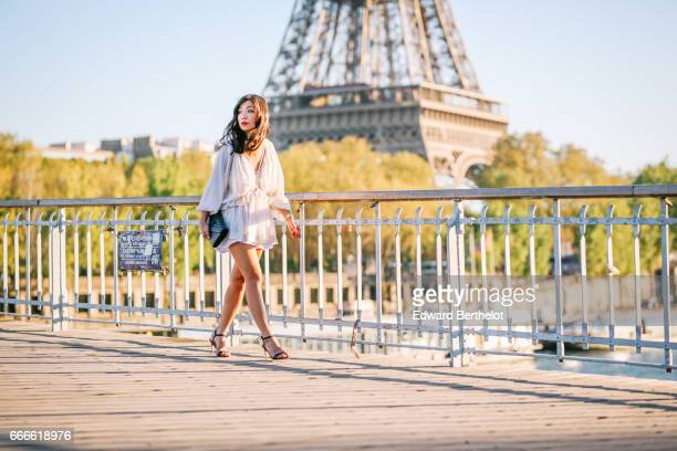 May Berthelot Head of Legal at Videdressingcom and fashion blogger wears a Magali Pascal white lace dress a Saint Laurent YSL black clutch and black...