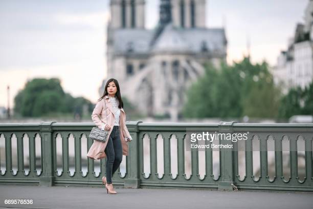 May Berthelot Head of Legal at Videdressingcom and fashion blogger wears a New Look pink trench coat Topshop gray denim jeans Louboutin Pigalle nude...