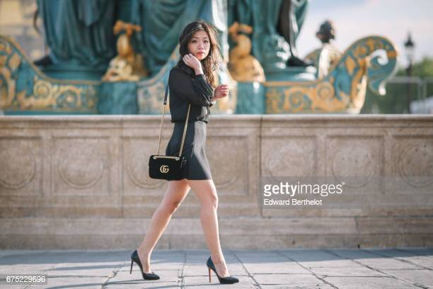 May Berthelot Head of Legal at Videdressingcom and fashion blogger wears a Harpe black meshed blouse a Topshop ruffled black skirt Louboutin Pigalle...