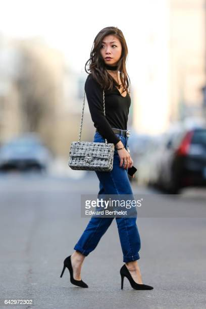 May Berthelot Head of Legal at Videdressingcom and fashion blogger wears an Ivy Revel black low neck top an Ivy Revel black choker Newlook mom blue...