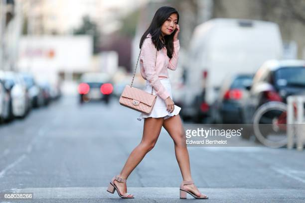 May Berthelot Head of Legal at Videdressingcom and fashion blogger wears Zara white short a New look pink shirt New Look pink sandals and a Chanel...