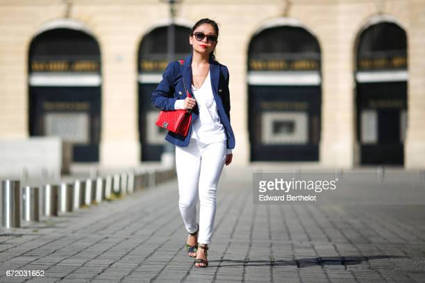 May Berthelot Head of Legal at Videdressingcom and fashion blogger wears Saint Laurent YSL sunglasses a Chanel Boy red bag a Zara white blouse a New...
