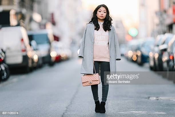 May Berthelot Head of Legal at Videdressingcom and influencer is wearing a Topshop gray coat a Rad pink sweatshirt with the inscription 'Champagne...
